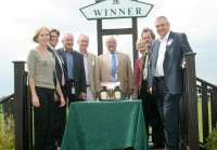 Smiling owners collect their prize