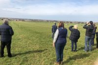 Owners watching their horse exercise with trainer Marco Botti