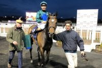 Kodiac Lass returns to the winners enclosure to her delighted Owners