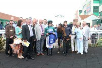 A proud group of owners and trainer Joe Tuite with their winner