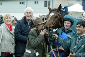 Deux Etoiles enjoys a winning kiss from his adoring owners