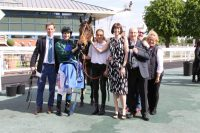 Delighted owners with their winner and trainer Philip Hide