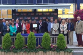 Owners collect their prize as Dragons Voice wins his second race