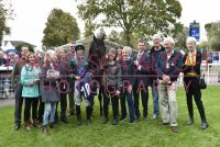 Thrilled owners gather with their 3-time winner