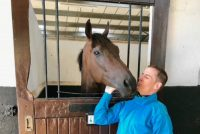 Winning jockey Fran Berry giving Dragons Voice a well done kiss!