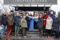 A huge gathering of Dynamic Idol's delighted owners collect their prize at Lingfield Park