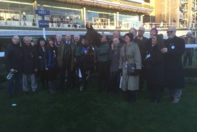 Owners gatSuch a popular horse amongst his owners!her in the parade ring to celebrate Fruity's win