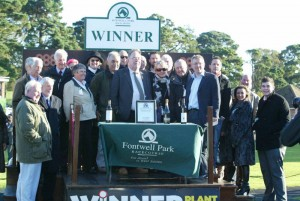 Delighted owners gather in the winners enclosure
