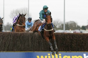 Fruity O'Rooney jumps over the last fence in front at Kempton Park