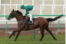Hector Crouch and Good Luck Charm cross the line the winners