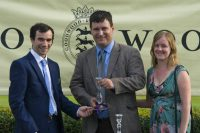 Mr & Mrs Hunt collecting their winning prize as Guns of Leros wins at Goodwood