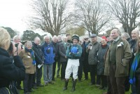 Jockey Jamie Moore poses with owners in the parade ring