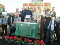 A big crowd of owners collecting their winning prize