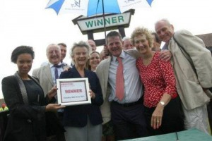 Joe Tuite celebrating his first win with delighted owners