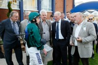 Owners & trainer Gary Moore get a debrief from jockey Ryan Moore