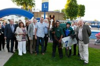 Jupiter Storm in the winners enclosure with his crowd of owners