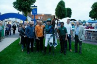 Owners & jockey pose with their winner