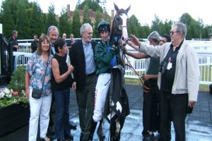 Delighted owners in the winners enclosure with Jupiter Storm