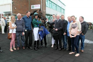 Lightning Spirit with her owners after her second career win