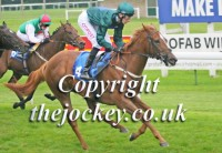 Marmalady wins well for George Baker
