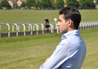 Marco watching his horses at work