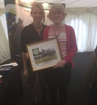 Jo Clay winning a photo of Zambeasy winning at Sandown Park