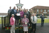 Owners collect their winning prize