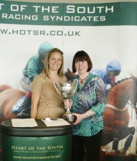 Owner Carol Brinson collecting her trophy courtesy of Peplum