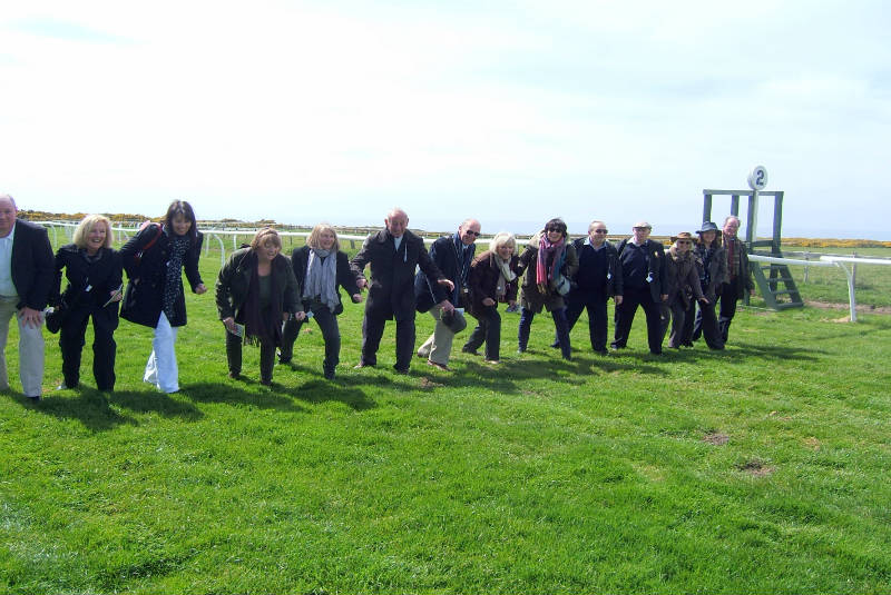 Owners line up at the start of the track