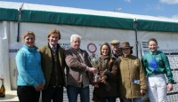 A thrilled bunch of owners collect their trophy
