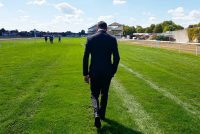 Trainer Marco Botti walks the course