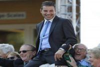Trainer Marco Botti celebrating with some elated Owners!