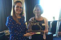 Miss Fleming winning a prize courtesy of Velvet Revolution!