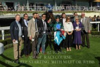 Owners gather in the winners enclosure with their winner