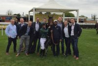 A proud group of owners with their winner!