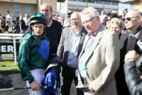 Owners receiving a debrief from jockey Jamie Moore
