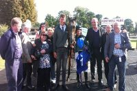 Thrilled owners in the winners enclosure with Sisania