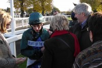 Jockey Ryan Moore receiving a congratulatory pat on the back from our owners