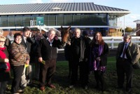 Delighted owners in the winners enclosure with their winner