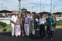 Some very happy Owners with their winner
