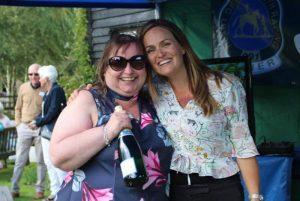 Long standing owner Shelley Bennett wins a bottle of champagne courtesy of Sisania