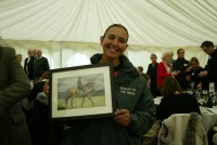Fruity O'Rooney's lass Suzy beams as she receives a photograph of her favourite horse!