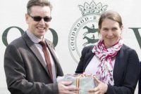 Suzy collecting a prize after celebrating a winner at Goodwood
