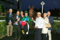 Delighted owners pose with their winner and jockey Martin Harley