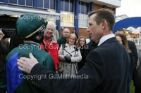 Jockey Jamie Spencer receives a well deserved pat on the back from trainer Philip HIde